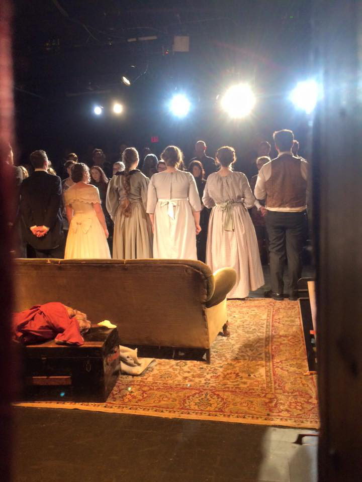 photo of actors on a stage taken from behind