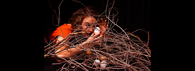 photo of a woman removing an egg from a nest